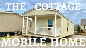 Tato malá chalupa mobilní dům mi připomíná malý dům !! Připojená veranda a další na vnitřní straně.